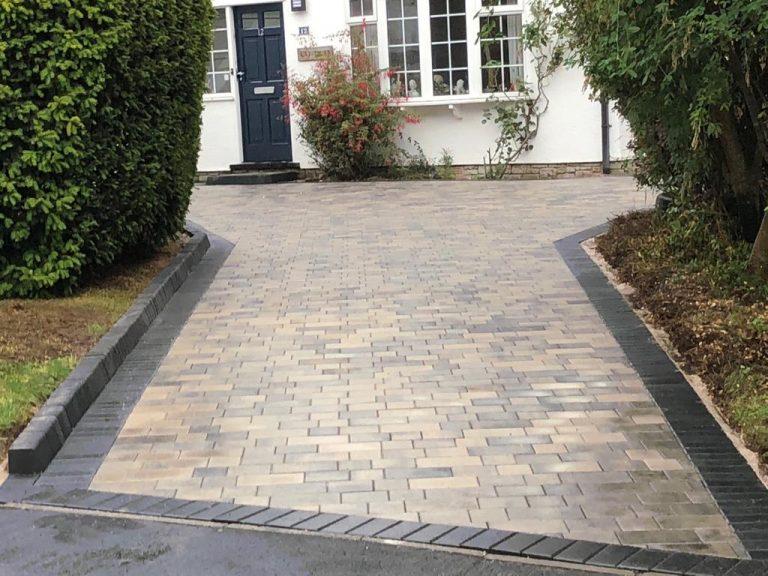 Charcoal bordered Tegula driveway